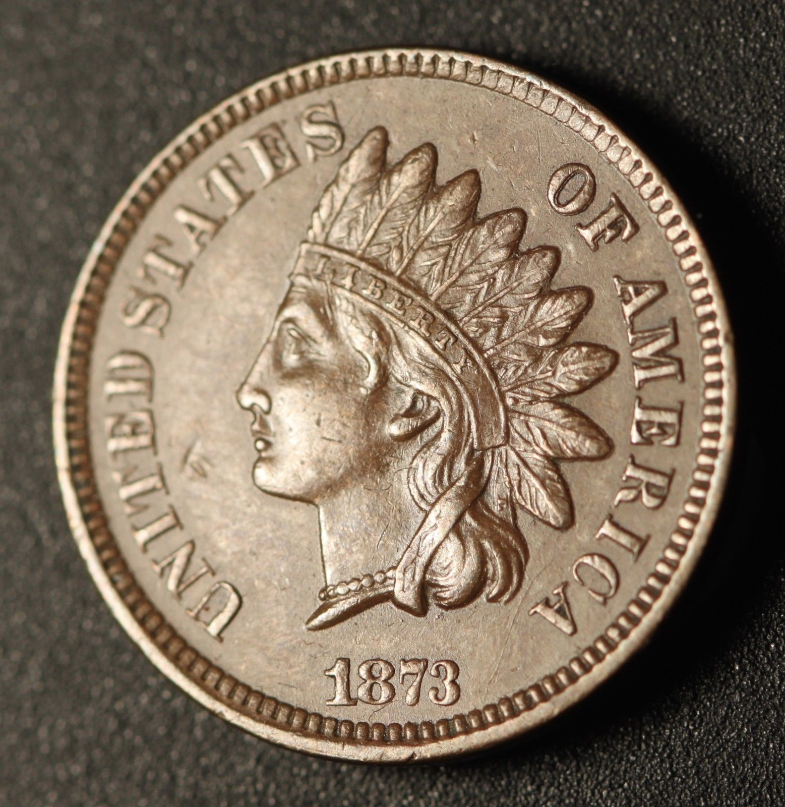 1873 Open 3 ODD-002 - Indian Head Penny - Photo by Ed Nathanson
